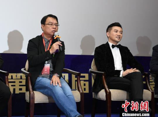 第十四届长春电影节评委,香港导演李力持(左)与苏有朋 张瑶 摄