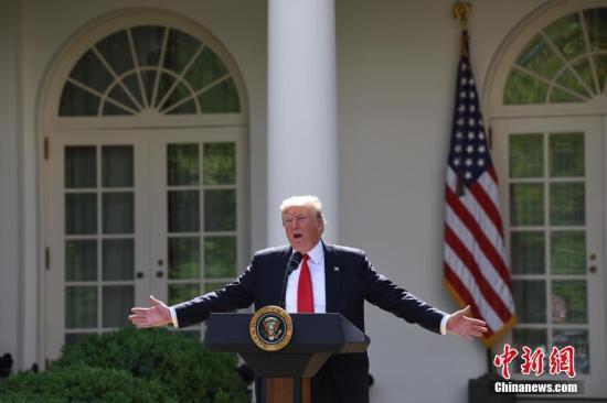 """当地时间6月1日,美国总统特朗普在白宫宣布,美国将退出《巴黎协定》。他同时强调,美国也许会重返有关应对气候变化的协定,但前提条件是协定必须要对美国更加""""公平""""。 <a target='_blank' href='http://www.chinanews.com/'>中新社</a>记者 刁海洋 摄"""